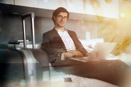 Traveler businessman with his laptop ready for the cruise ship vacation. Double exposure