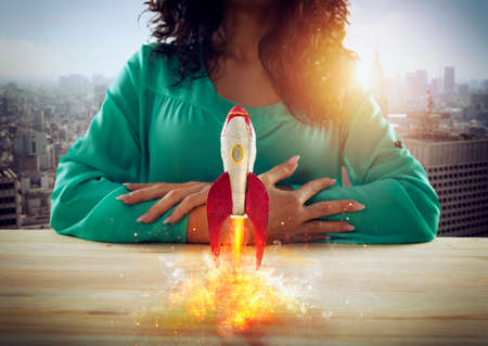 Businesswoman launches his company with a rocket. Concept of startup and innovation.