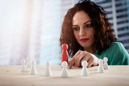 Businesswoman team leader thinks about the strategy of company team.