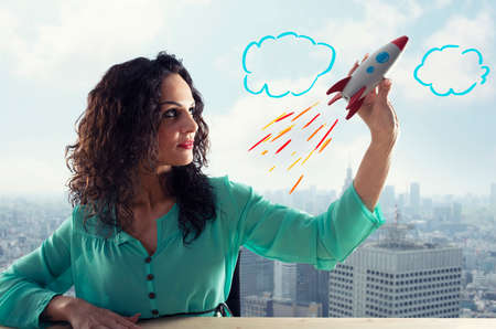 Businesswoman launches his company with a rocket. Concept of startup and innovation. 版權商用圖片 - 122649645