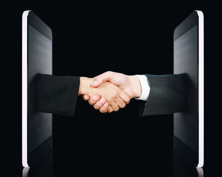 Hands comes out of the screen to sign an agreement or to know each other