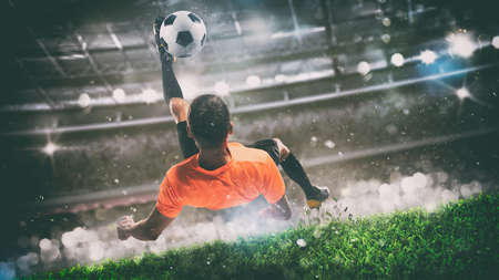 Football scene at night match with player ready to shoot the ball