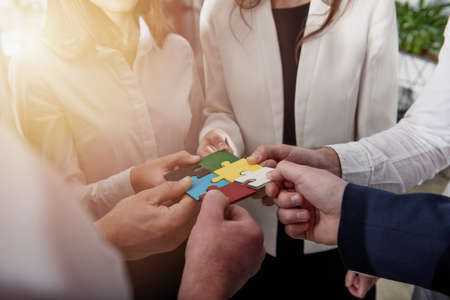Teamwork of partners. Concept of integration and startup with puzzle pieces. Banque d'images