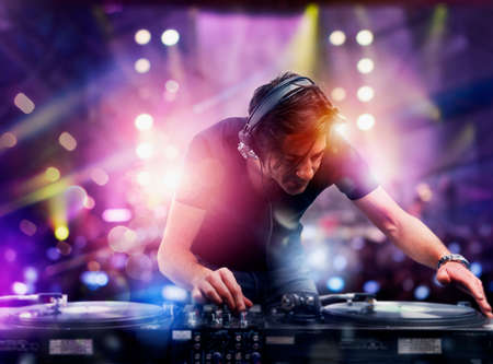 DJ playing music at the discotheque Stock Photo