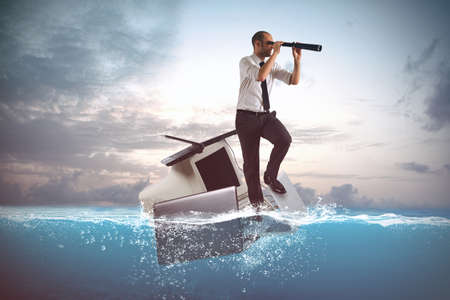 Businessman sailing on a laptops and personal computer in the sea Stock Photo