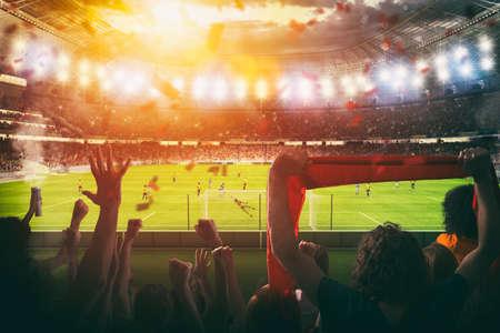Fußballszene bei Nachtspiel mit jubelnden Fans im Stadion
