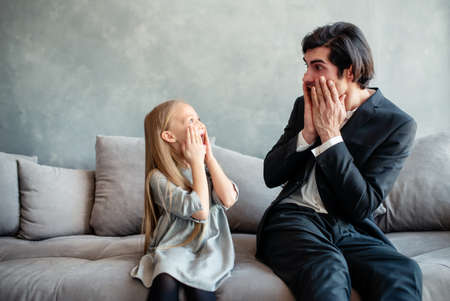 Father and daughter look together shocked something