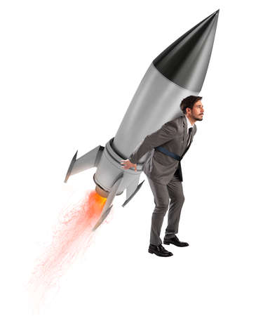 Determination and power businessman that holds a rocket isolated on white background. Increase, away.