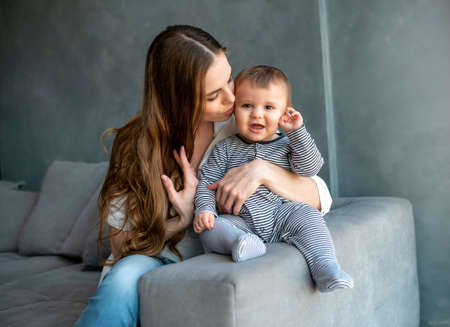 Little child smiling and happy with mom