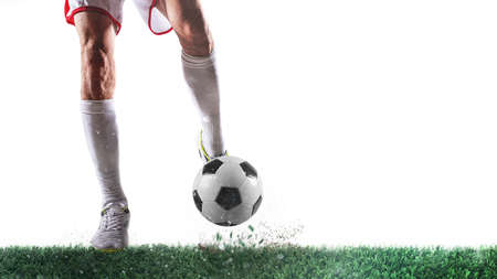 Football scene with player ready to shoot the ball on white background Фото со стока