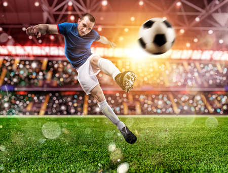 Soccer player kicks the ball vigorously at the stadium Banque d'images - 134780360