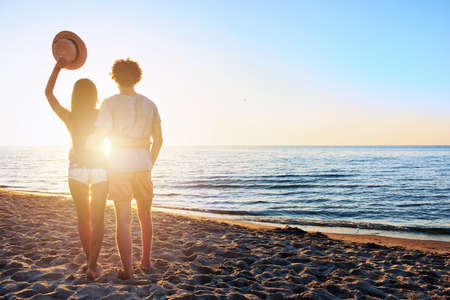 Couples during a sunrise at the beach