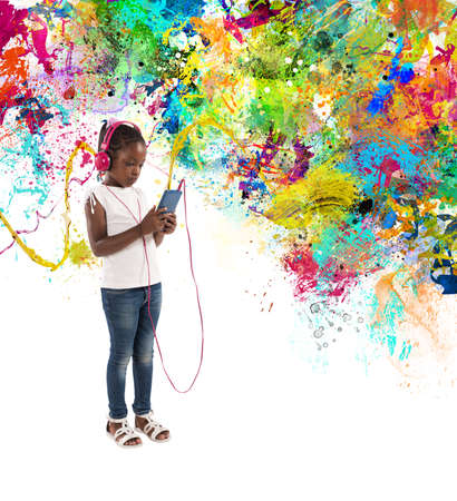 Young child listens to music with splash effects