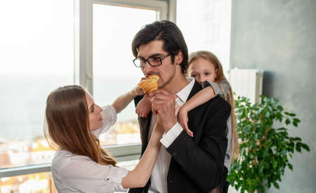 Happy family have a breakfast at home