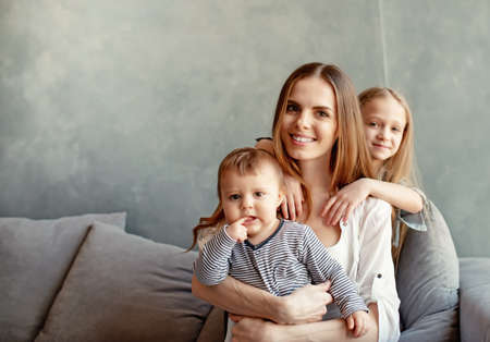 Happy young mother with her children at home 版權商用圖片