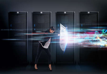Concept of safety in a data center room with database server. Woman with shield defends against hacker attacks 版權商用圖片