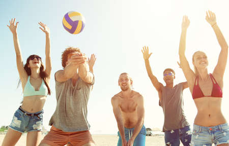 Group of friends playing at beach volley at the beach Reklamní fotografie