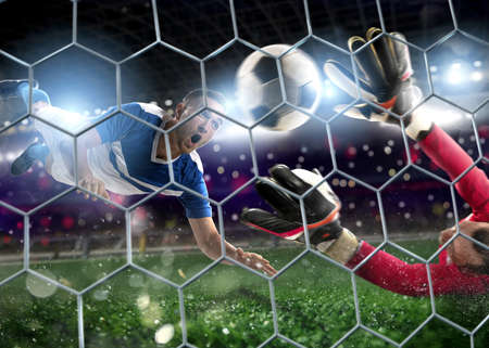 Goalkeeper catches the ball in the stadium during a football game. Stockfoto - 125019101