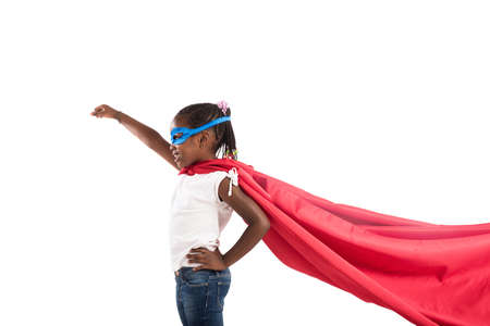 Child acts like a superhero to save the world Banco de Imagens