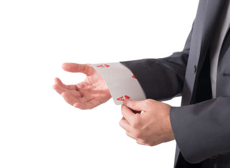 Businessman out of sleeve a poker card Stock Photo