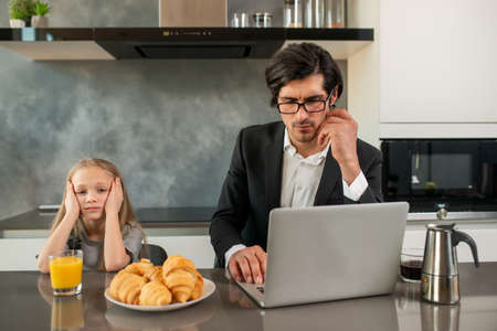 Unhappy daughter annoyed due to father work Reklamní fotografie