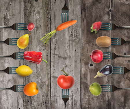 Background of forks with various vegetables and fruits