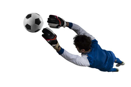 Goalkeeper catches the ball in the stadium during a football game. Isolated on white