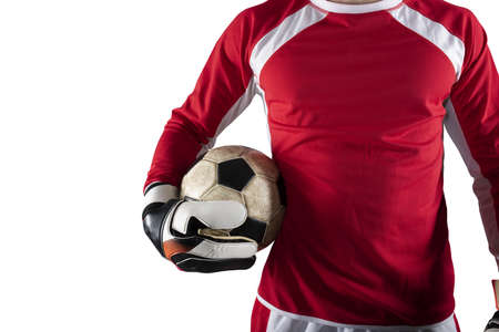 Goalkeeper holds the ball in the stadium during a football game. Isolated on white