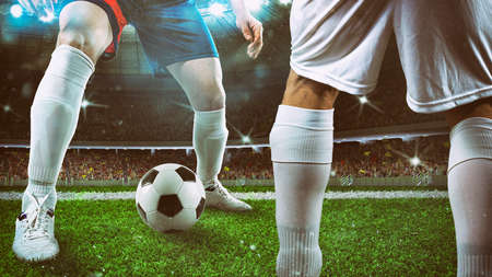 Close up of a soccer player holding the ball for a dribbling at the stadium during the night match
