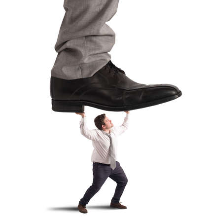 Crushed by boss Stock Photo