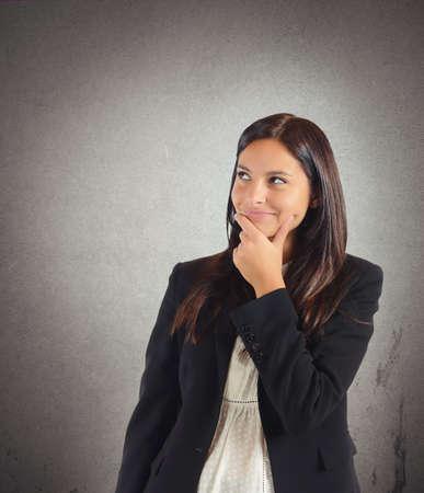 Businesswoman invents lie Stock Photo
