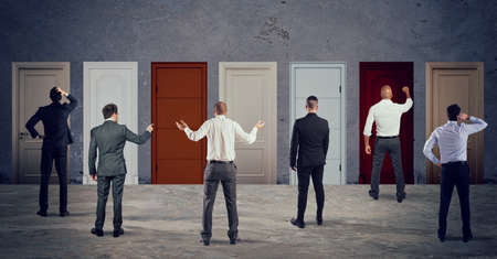 Business people looking to select the right door. Concept of confusion and competition Archivio Fotografico - 127025455