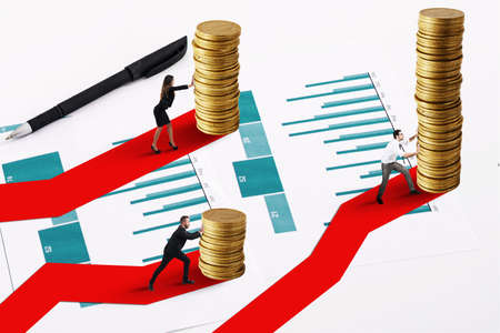 Businessmen moves a pile of golden coins. Concept of financial investment growth