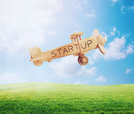 Flying toy aircraft. Concept of company startup and business success