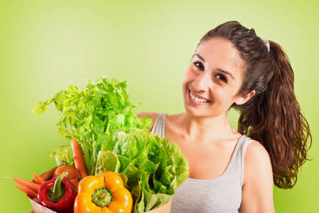 Beautiful girl with vegetables in the bag. Green style