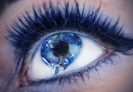 Eye with inside the World. Earth is crying due to pollution, wars, terrorism. Globe provided by NASA