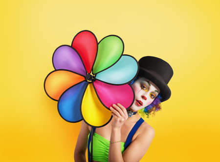 Clown with colored helix on yellow background 写真素材