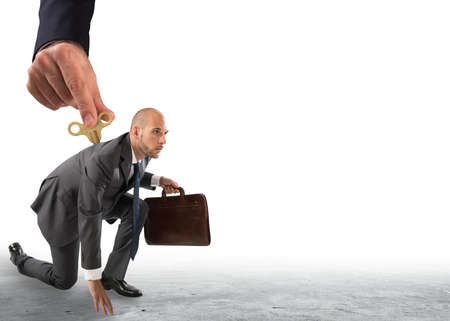 Hand from above giving the charge to a businessman ready to go. Stockfoto