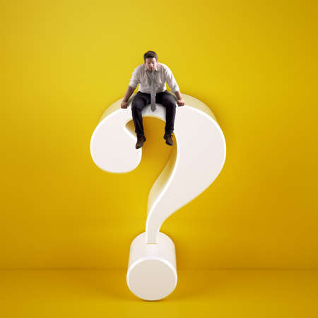 Man sitting on top of a big white question mark on a yellow background Stok Fotoğraf
