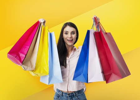 Happy woman with shopping bags in hand.