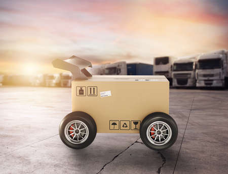 Priority Cardboard box with racing wheels like a car. Fast shipping by road.