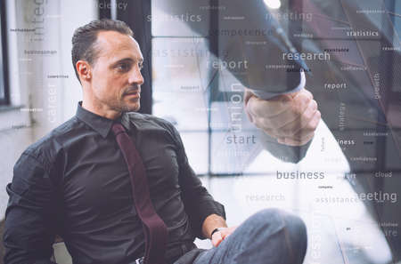 Confident businessman during a meeting. He watches far for future business vision. Handshake with partner in overlay Stockfoto - 131309903