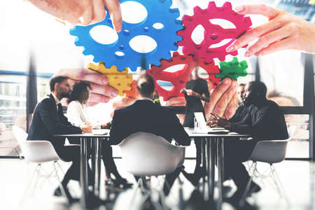 Business team connect pieces of gears. Teamwork, partnership and integration concept. Stockfoto - 132006020