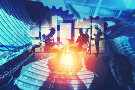 Business team connect pieces of gears. Teamwork, partnership and integration concept. double exposure with light effects Stockfoto