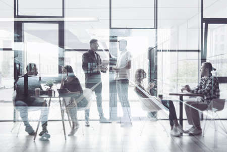 Concept background with business people silhouette working in a modern office. Double exposure Stockfoto