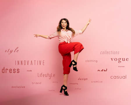 Brunette girl with red clothes jumps over a pink with fashion terms.