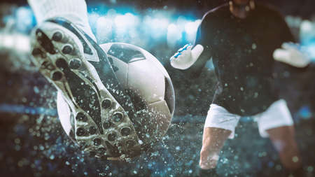 Football scene at night match with close up of a soccer shoe hitting the ball with power Stockfoto