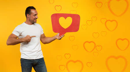 Man is happy because receives hearts on social network