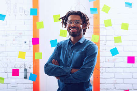 Businessman that smiles in office. Concept of positivity and success Zdjęcie Seryjne