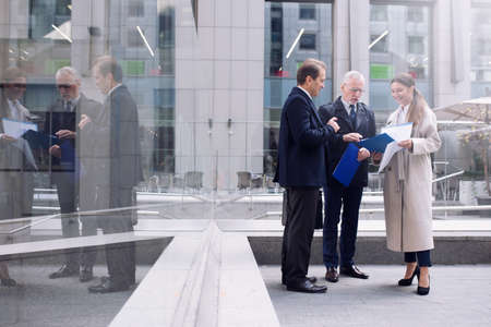 Businessmen that work together outdoors. concept of teamwork and partnership. Zdjęcie Seryjne